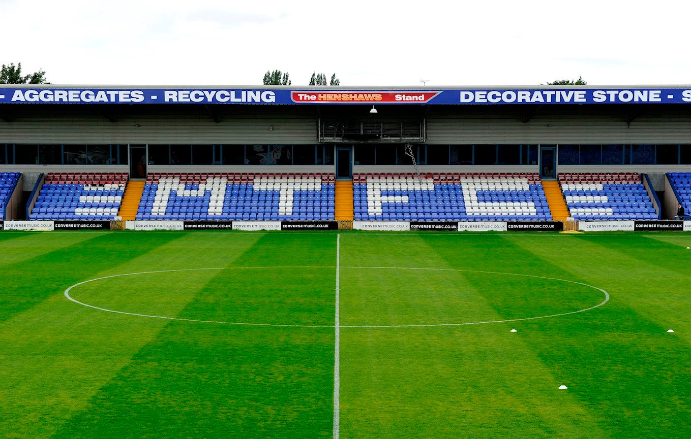 Macclesfield-Town-FC-Moss-Rose-Stadium-main-stand-from-PA.jpg